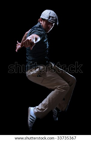 Cool looking dancer  on black background