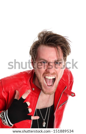 Cool looking rocker guy wearing a black tank top and a Red leather jacket, with torn jeans. White background. - stock photo