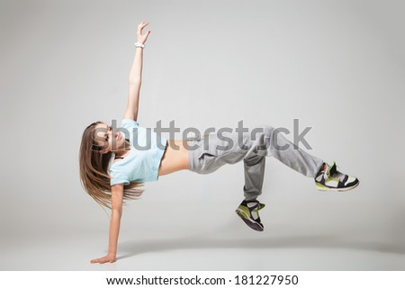 cool looking two dancing woman on grey background - stock photo