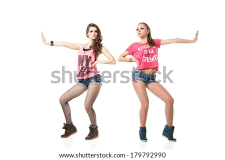 cool looking two dancing women on white background - stock photo