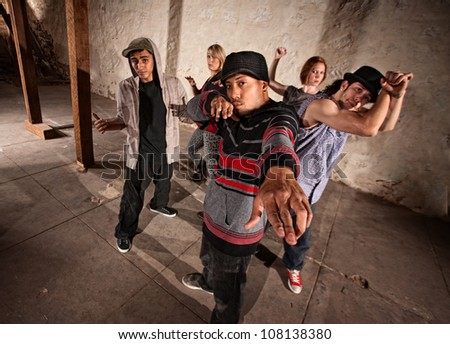 Cool Mexican break dancers in underground setting - stock photo