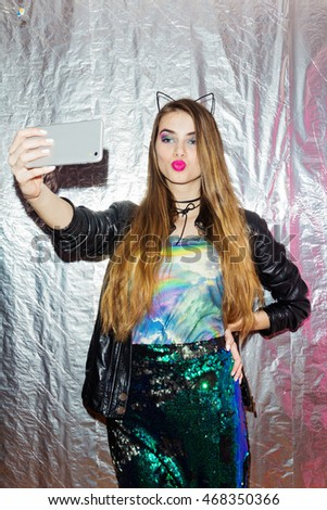 Cool Millennial Teenage Girl In Modern Fashionable Clothes, Taking A Selfie  On Smart Phone.