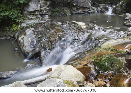 Cool mountain brook waterfall, Romanian Carpathians - stock photo
