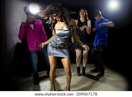 cool people dancing in a nightclub or bar lounge