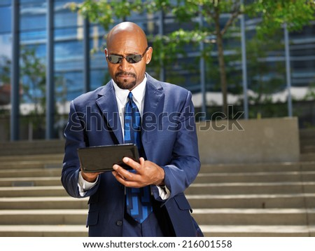 cool professional business executive working with tablet - stock photo