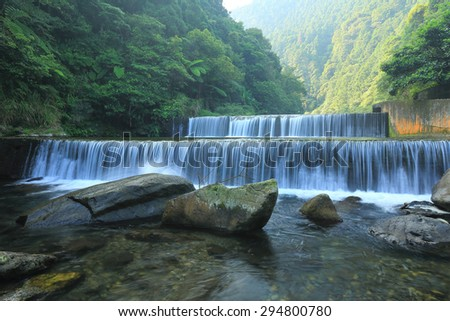 Cool refreshing cascades hidden in a mysterious forest of lush greenery ~ Beautiful scenery of Taiwan - stock photo