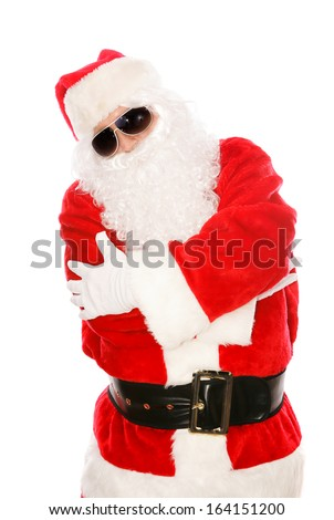 Cool Santa Claus in hip-hop pose with dark sunglasses on.  Isolated on white.   - stock photo