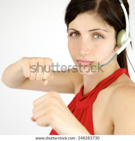 Cool secretary with punch and headset - stock photo