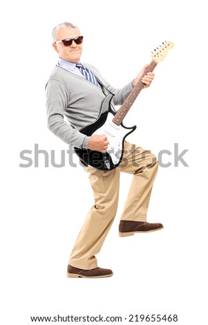 Cool senior playing an electric guitar isolated on white background - stock photo