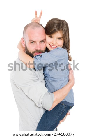 Cool stepfather father holding young daughter in his arms