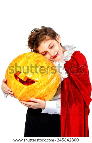 Cool teen boy in a costume of vampire posing with pumpkin with different emotions. Halloween. - stock photo
