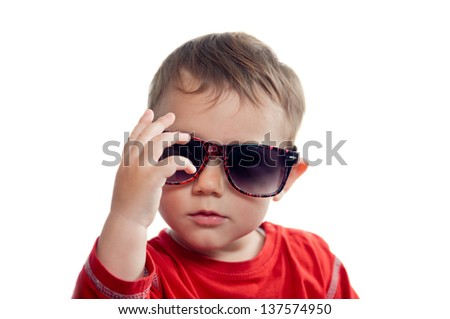 Cool toddler wearing sunglasses isolated on white - stock photo