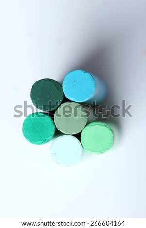 cool tone colorful chalk pastels on white background - selective focus - stock photo