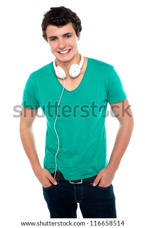 Cool trendy teenager boy with headphones around his neck. Posing casually and smartly - stock photo
