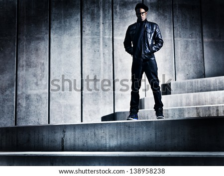 cool urban african american man on distopic concrete steps - stock photo