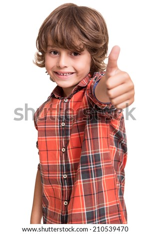 Cool young boy doing thumbs up over white