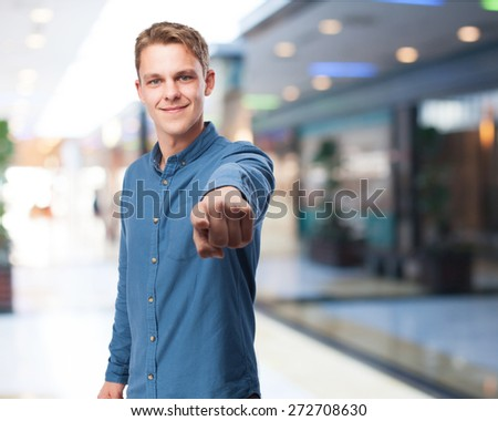 cool young-man pointing-front