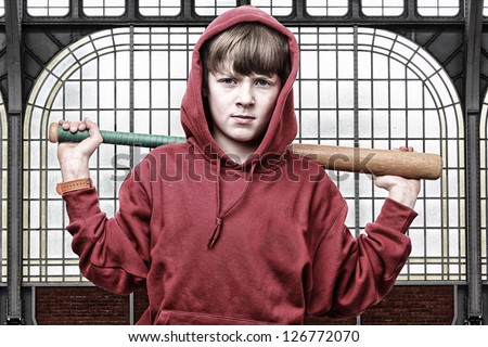 Cool young teenage boy with a baseball bat - stock photo