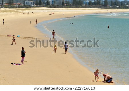 COOLANGATTA - OCT 07 2014:Visitors in Kirra beach.Coolangatta was one of the earliest settlements on the Gold Coast today it's a very popular tourist destination in Australia.