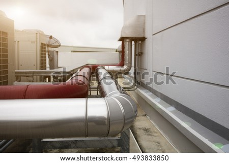 coolant pipe and red  fire water supply  with sun light