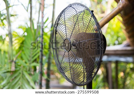 cooling, freshness and heat concept - close up of fan outdoors - stock photo