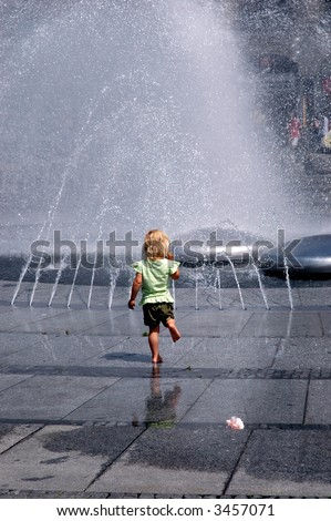 Cooling off in a fountain - stock photo