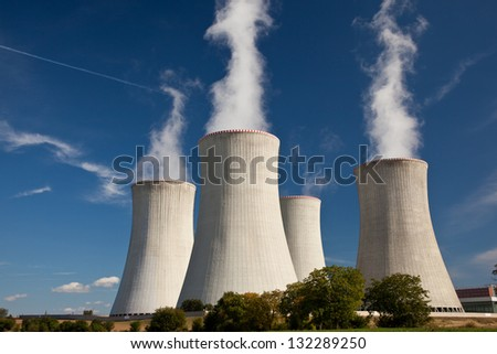 Cooling tower at nuclear power plant - stock photo