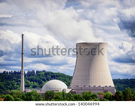 cooling tower - cooler - in front of cloudy sky - stock photo