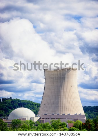 cooling tower - cooler - in front of cloudy sky