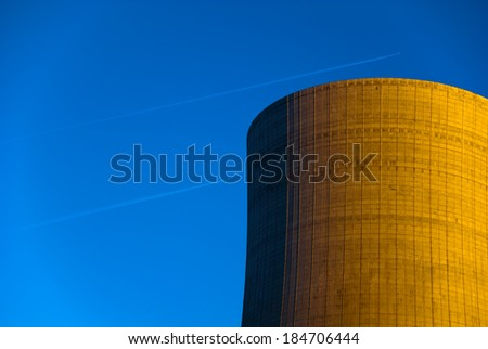 Cooling tower of a coal power plant and 2 aircraft - stock photo