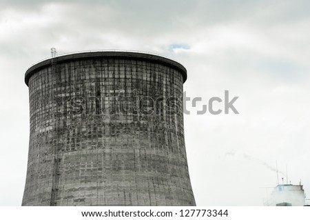 Cooling tower with sky and fumes - stock photo