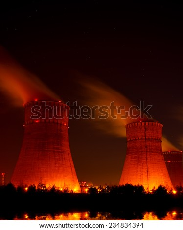Cooling towers of power plant at night