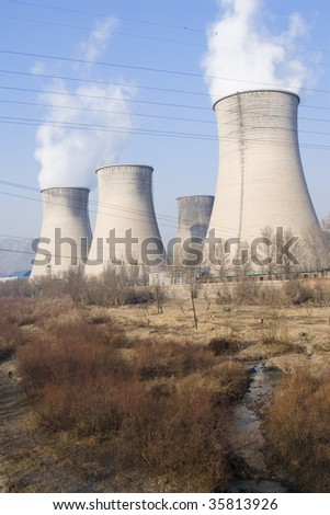 cooling towers of power plant in northern china. - stock photo