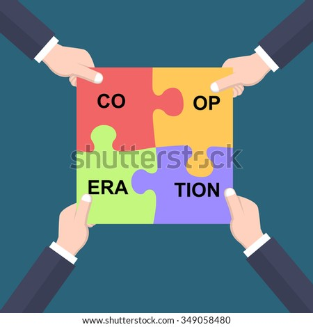 Cooperation concept hands joining puzzle pieces - stock photo