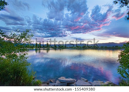 Coot lake with a colorful sky at sunrise. The was a breeze that went up and down,  it was a very mellow sunset that produced a very little color and most of it was about ten minutes after sunset.    - stock photo