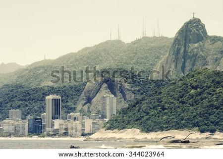 Copacabana Beach and Christ, symbol of Rio de Janeiro, standing on top of Corcovado Hill, Rio de Janeiro, Brazil - stock photo
