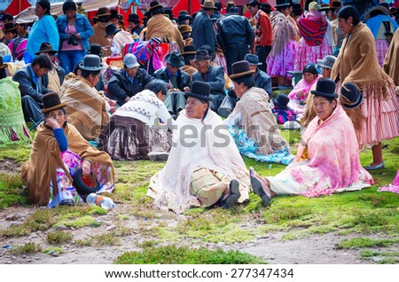 Copacabana, Bolivia-March 23, 2015:Bolivian  women in traditional clothes on the street Copacabana. - stock photo