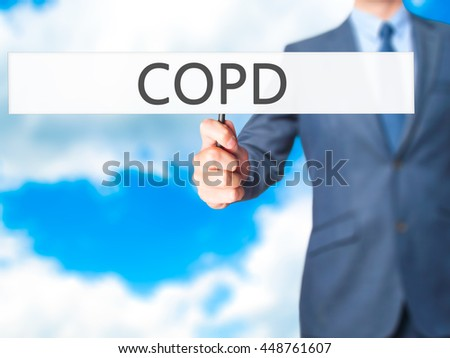 COPD - Business man showing sign. Business, technology, internet concept. Stock Photo