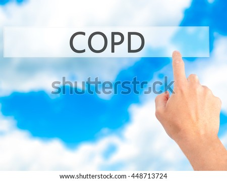 COPD - Hand pressing a button on blurred background concept . Business, technology, internet concept. Stock Photo