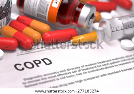 COPD - Printed Diagnosis with Red Pills, Injections and Syringe. Medical Concept with Selective Focus. - stock photo
