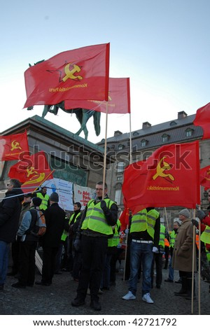 COPENHAGEN - DEC 12: Demonstrators hold communist flags in front of the parliament at the UN Climate Change Conference on December 12, 2009 in Copenhagen, Denmark. - stock photo