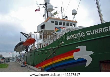 """COPENHAGEN – DEC 5: Greenpeace ship """"Arctic Sunrise"""" is shown docked in the harbor area during the UN Climate Change Conference on December 5, 2009 in Copenhagen. - stock photo"""