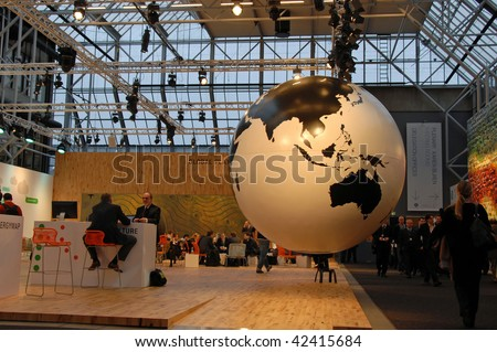 COPENHAGEN - DEC 7: Opening Day, Visitors in the Bella Center pass the Globe of Climate Consortium Denmark at the UN Climate Change Conference on December 7, 2009 in Copenhagen, Denmark. - stock photo