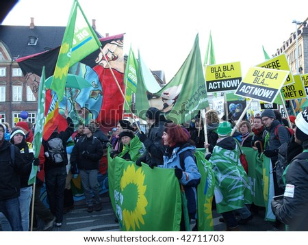COPENHAGEN - DEC 12: 100,000 participants and marchers join the UN Climate Change Conference Demonstration from the Parliament of Denmark to Bella Center on December 12, 2009 in Copenhagen Denmark. - stock photo