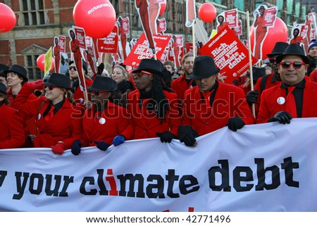 COPENHAGEN - DEC 12: Tens of thousands of people demonstrate in the Danish capital for speedy action by the UN climate conference to halt global warming on December 12, 2009 in Copenhagen, Denmark. - stock photo