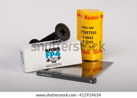 COPENHAGEN, DENMARK - APRIL 1 2016: Kodak and Ilford film pictured along with a Bronica darkslide for medium format cameras on April 1 2016 in Copenhagen, Denmark