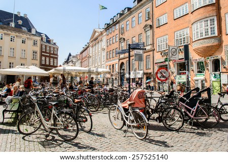COPENHAGEN, DENMARK - AUGUST 12: Bikes on the street on August 12, 2014 in Copenhagen. - stock photo