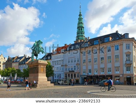 COPENHAGEN, DENMARK - AUGUST 22, 2014: Hojbro Plads, the square in the historical center of Copenhagen. The main feature of this square is equestrian statue of Bishop Absalon, founder of Copenhagen.