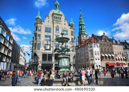 COPENHAGEN, DENMARK - AUGUST 15, 2016: Many people near fountain Stork on Amagertorv square at the city centre. Copenhagen is the capital and most populated city of Denmark on August 15, 2016.