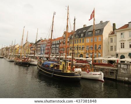 COPENHAGEN, DENMARK - CIRCA JUNE 2016: Pictorial view of the old port Nyhavn (actually meaning  New Port), popular touristic landmark of Copenhagen, built in 17th-century - stock photo
